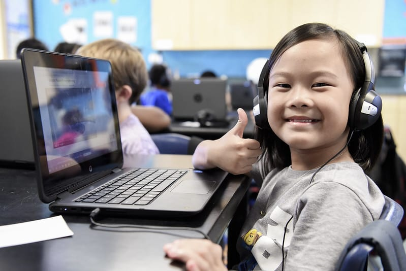 Student giving thumbs up